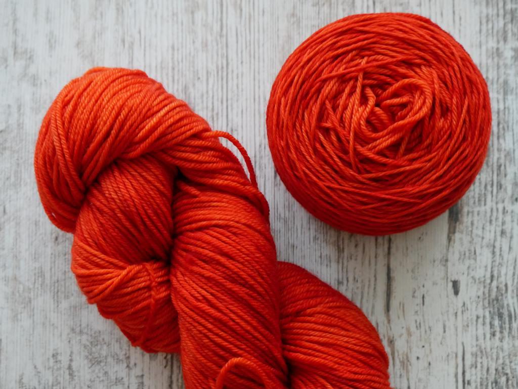 photo of red-orange yarn what you need to begin crochet photo