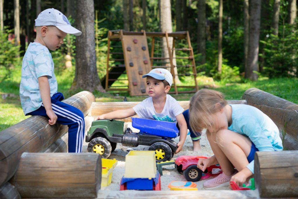 photo of children playing in a sandbox