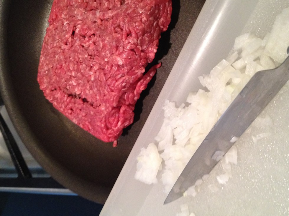 Add chopped onion to ground beef for browning.   Tidbit Tip:  When scraping food from the chopping board use the back edge of the knife to protect the sharp blade edge of the knife.