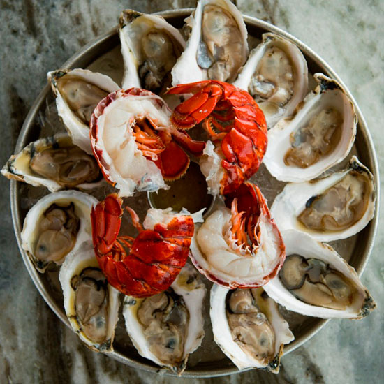 plate of freshly shucked oysters and lobster