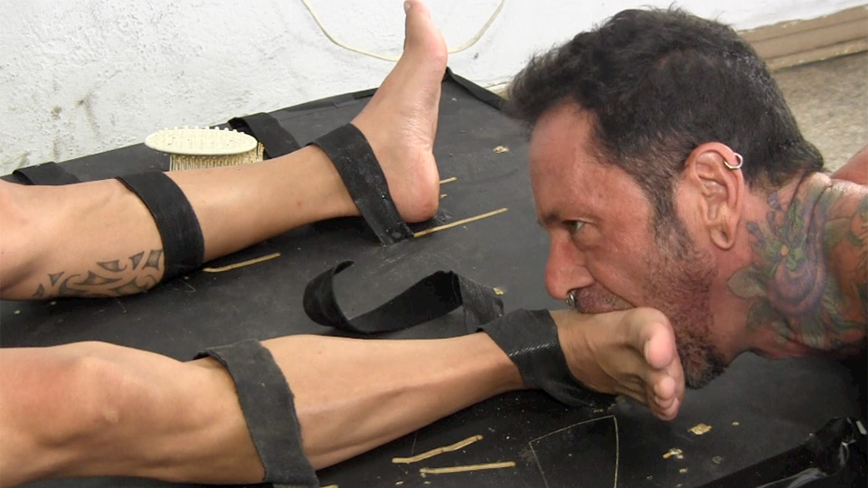 Guy gets his feet tied licked