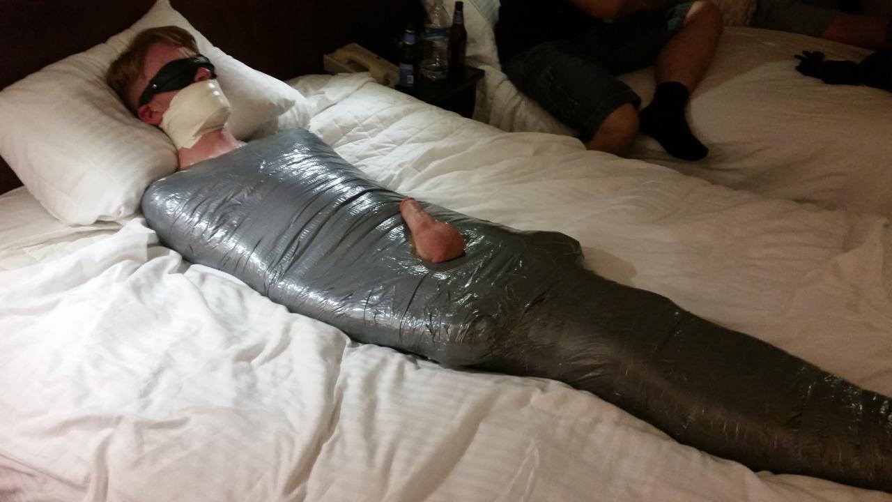 Latex mummy bondage