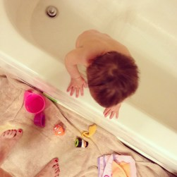Ready to get out the bath. Drained the tub, threw her toys out, and stood up!