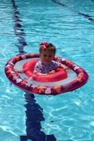 In her Swimways float.