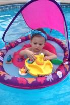 In her Swimways floast.