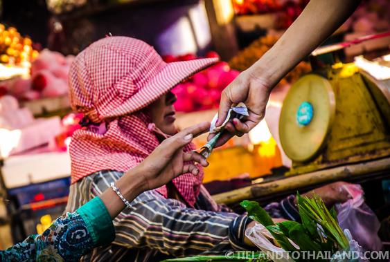 Money Changing Hands at Ban Khlong Luek Border Market