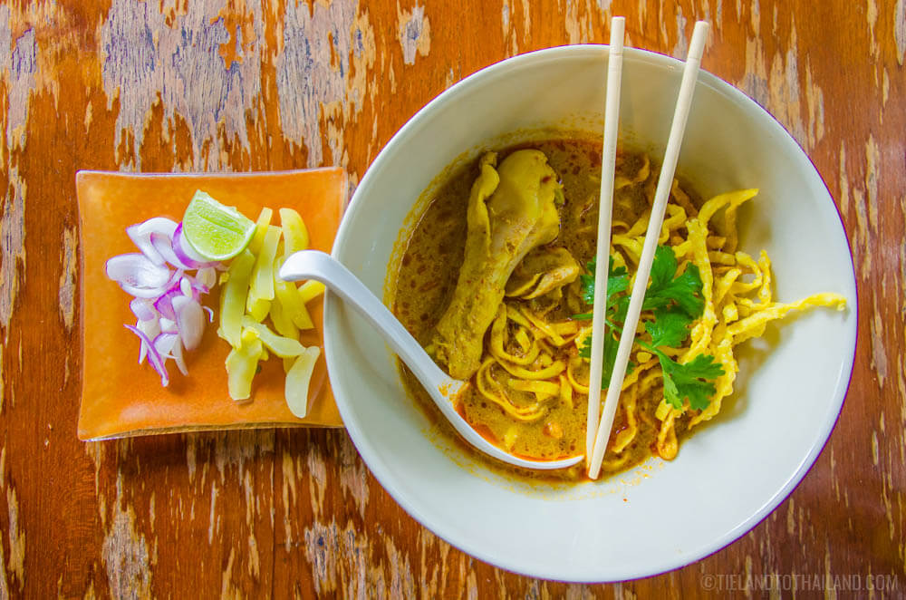 Bowl of khao soi gai, or Northern Thai yellow curry with chicken