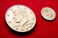 moneda jumbo medio dólar plateada