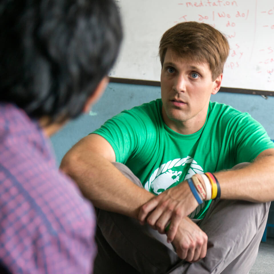 Tim Kobus works discusses techniques during a teaching workshop.