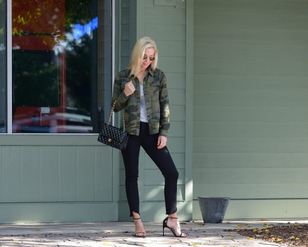 A simple outfit of black jeans, a grey tshirt and a camo shirt layered on top is perfect for date night, girls night out or add flats and it is good for errands or coffee.