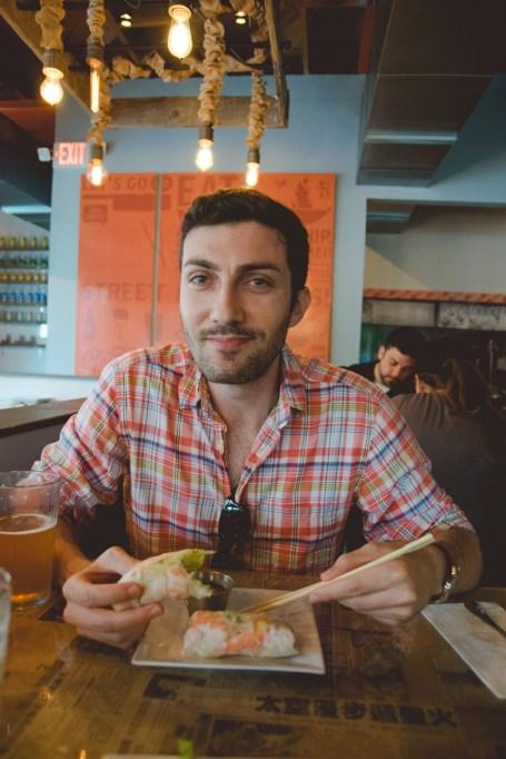 Josh eating his Vietnamese Shrimp Summer Roll. Pretty authentic!