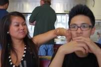 Taqueria was a Mexican restaurant we used to frequent in high school. Kim wipes food off of Bryan's face.