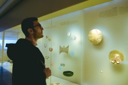 Josh looks at things on display.