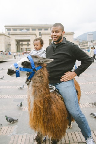 Riding a llama with your baby is totally normal in America.