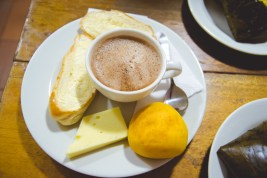 This hot chocolate is a traditional Colombian drink, served with buttered bread, white cheese, & almojábana, all perfectly matched to dip in the hot chocolate.