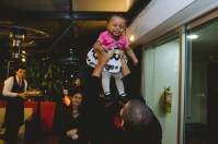 Daddy Christian lifts baby Caliah into the air & she couldn't be happier.