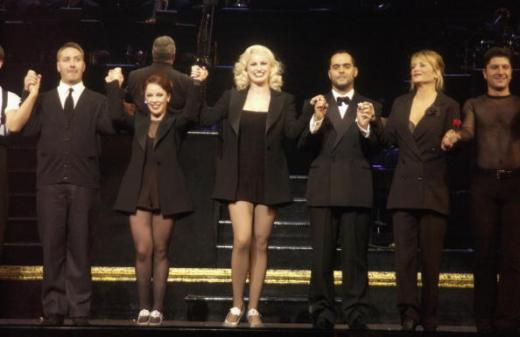 "LONDON - NOVEMBER 20: David Birrell, Linzi Hateley, Tiffany Graves, Michael Greco and and Gaby Roslin perform on stage at Gaby Roslin and Michael Greco's opening night in ""Chicago"" at The Adelphi Theatre on November 20, 2002 in London. (Photo by Dave Benett/Getty Images)"