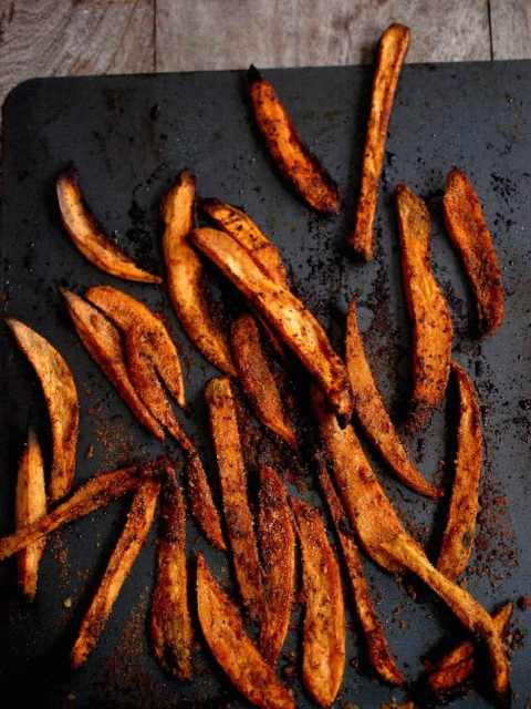 Sweet potato fries on a tray on a table