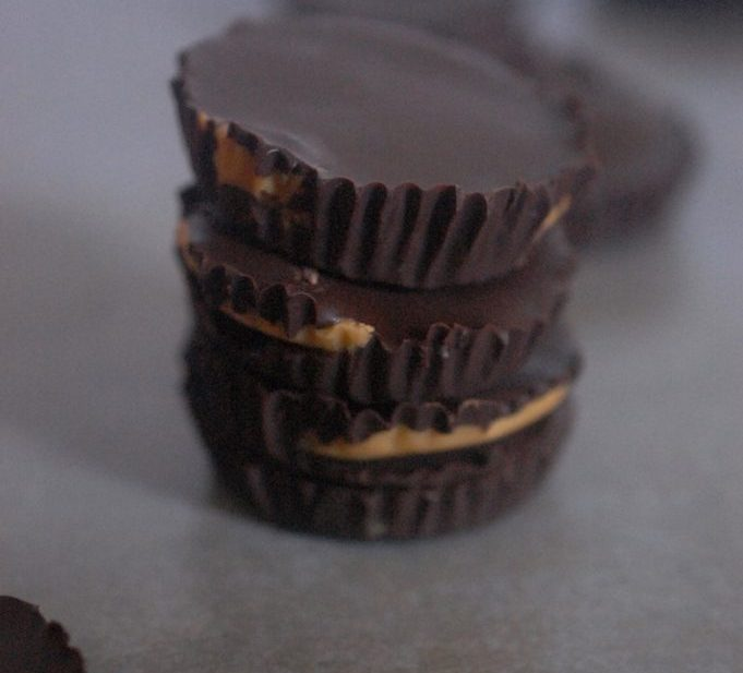 Chocolate Peanut butter cups pile on grey background