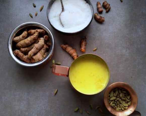 Three bowls with ingredients and one cup of turmeric tea