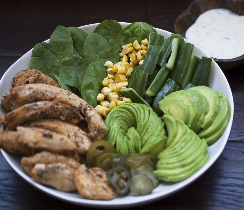 Cajun chicken salad with dipping sauce in bowl