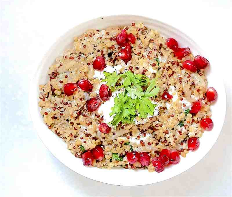 Freekeh with a lemon garlic yoghurt and pomegranate in bowl