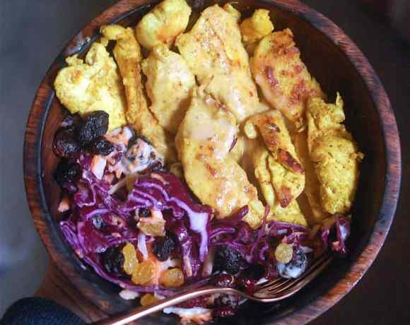 chicken satay salad and cabbage salad in wooden bowl