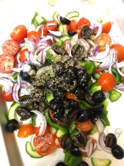 Salad ingredients and dressing on a plate