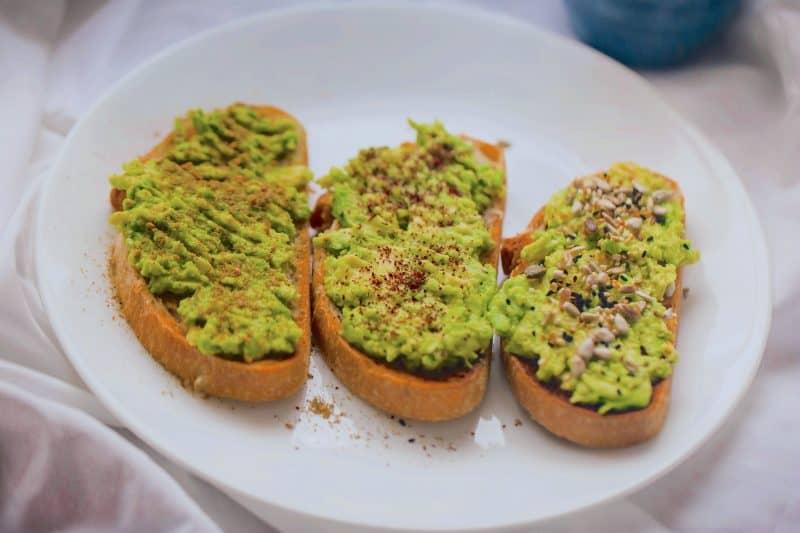 Smashed avocado on 3 toast on plate