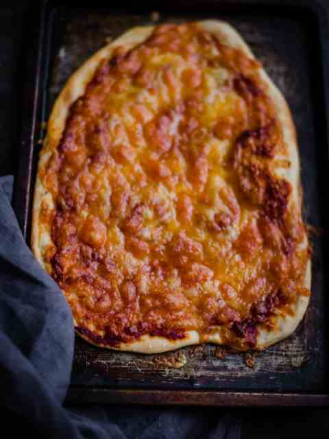 Cheese and Tomato Pizza on a baking tray
