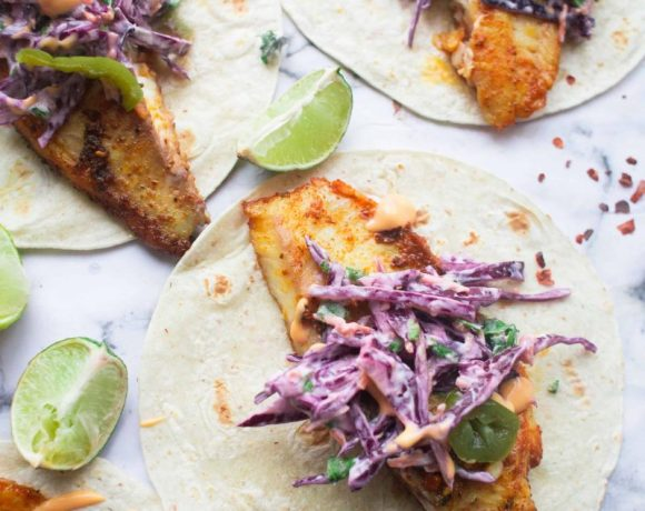 Fish Tacos with Slaw and lime wedges