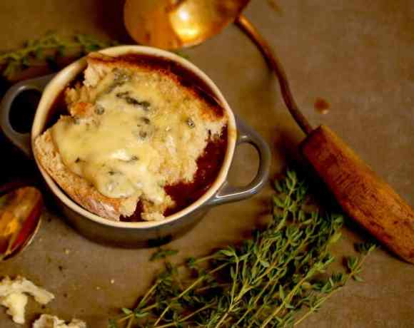 French Onion Soup topped with blue cheese toast
