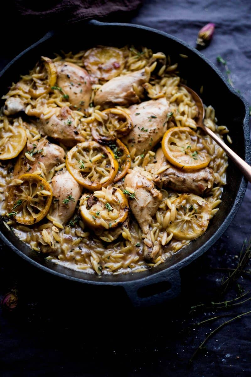 One Pot Lemon Chicken and Thyme Orzo with lemons on top and spoon