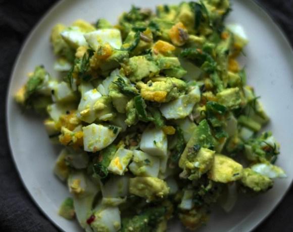 Green Chilli Avocado Egg Salad on plate on grey towel