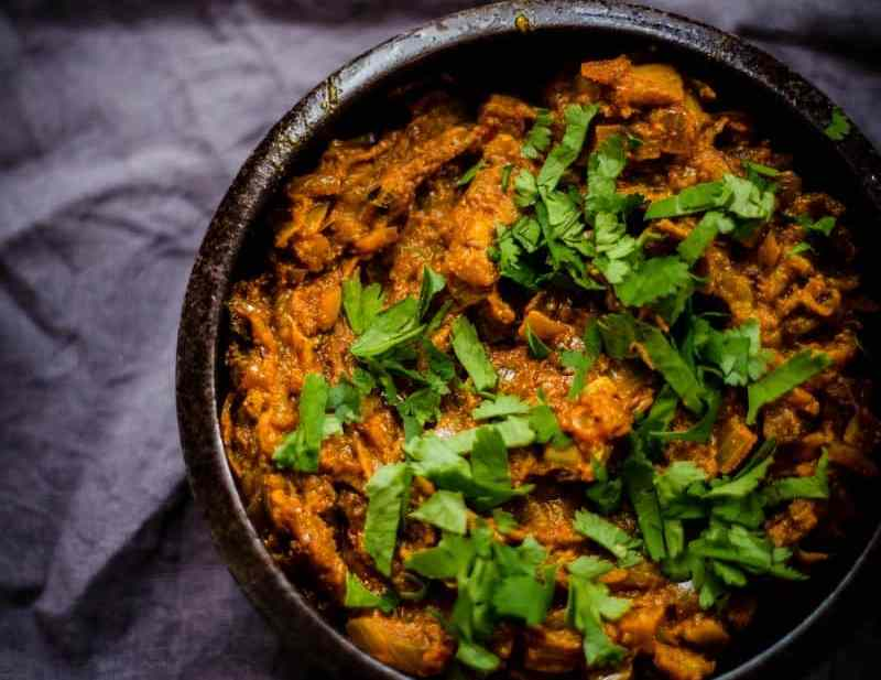 Baingan Bharta topped with coriander in a bowl