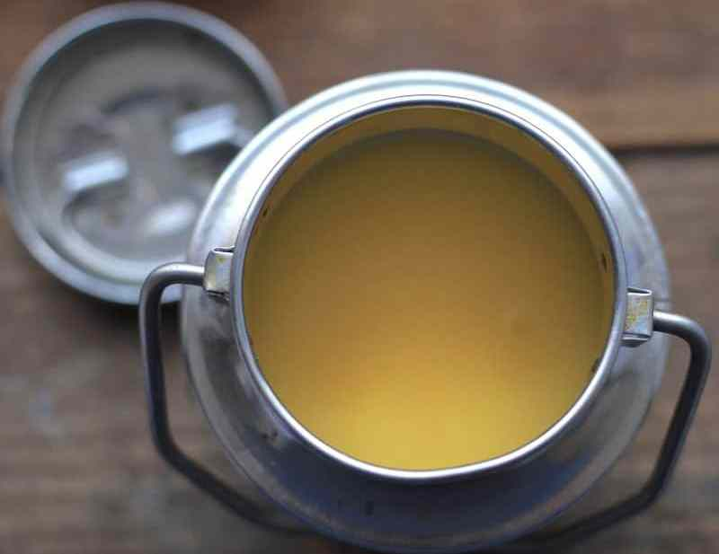 Solid ghee in traditional silver indian pot