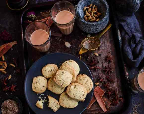 Jeera Shortbread in plate on tray with Masala Chai