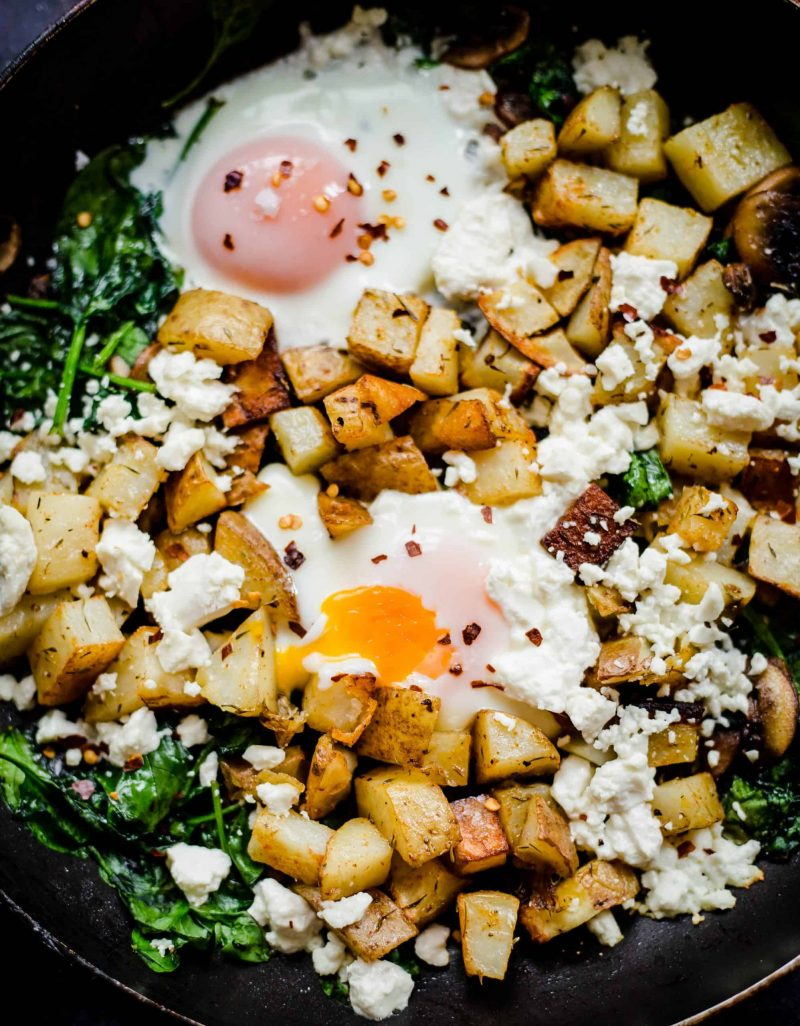 Egg, Potato cubes, spinach and mushrooms in pan