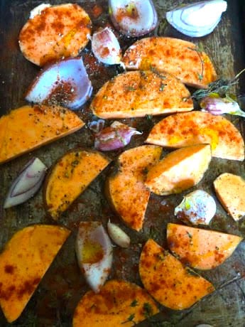 Sweet potatoes, red onions and garlic n oven tray with paprika and oil