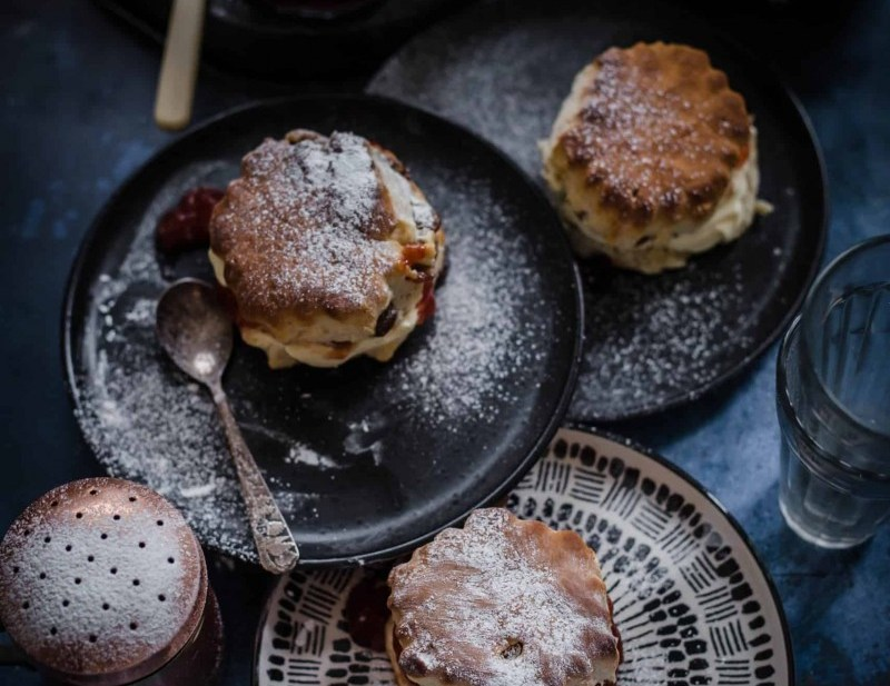 Scones in 3 plates with jam and cream