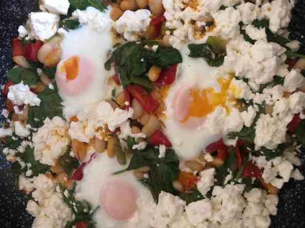 Showing jammy eggs in Shakshuka