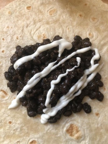 Black beans topped with sour cream