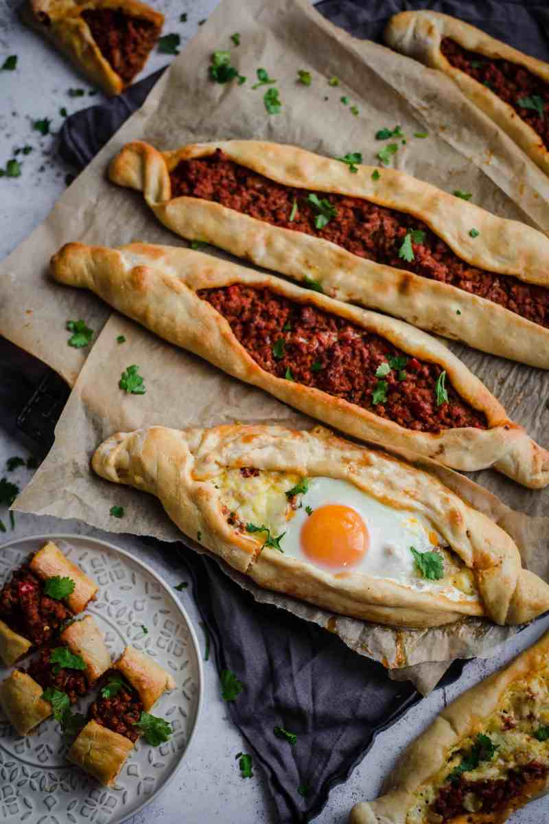3 Pide on baking paper and one cut into pieces on plate
