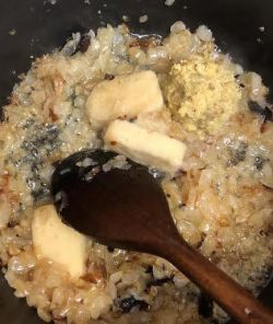 Golden onions with ginger/garlic added to them in wok