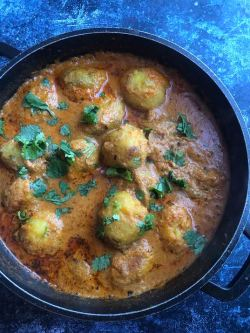 Potatoes added to pot with coriander on top