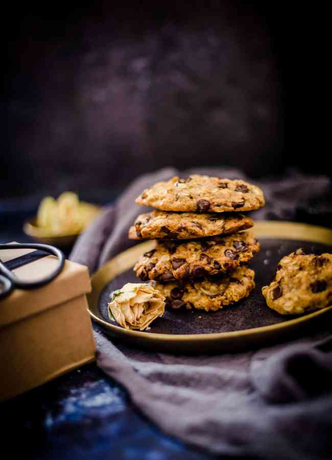 4 oat cookies piled on a plate