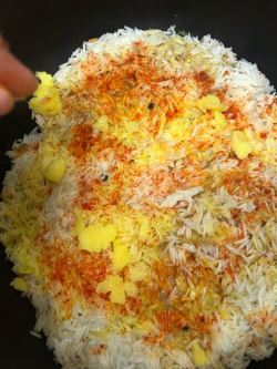 Ghee dotted all over the top of rice