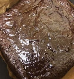 Brownies half baked in tin