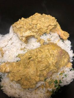 Chicken added on top of rice layer