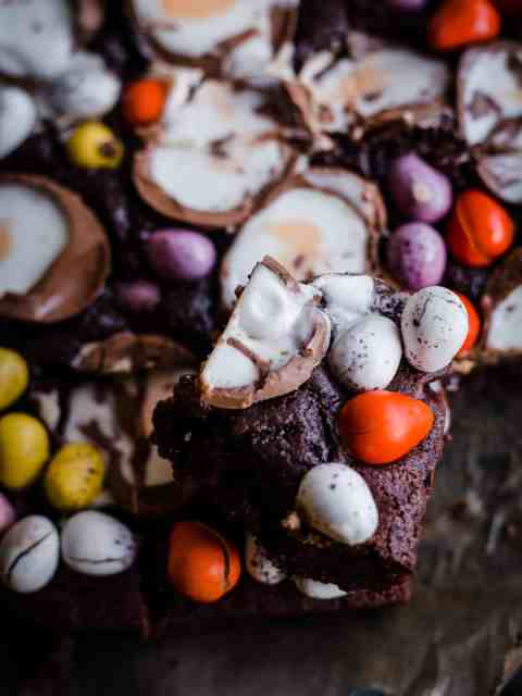 Brownies with creme eggs and min eggs all over the surface